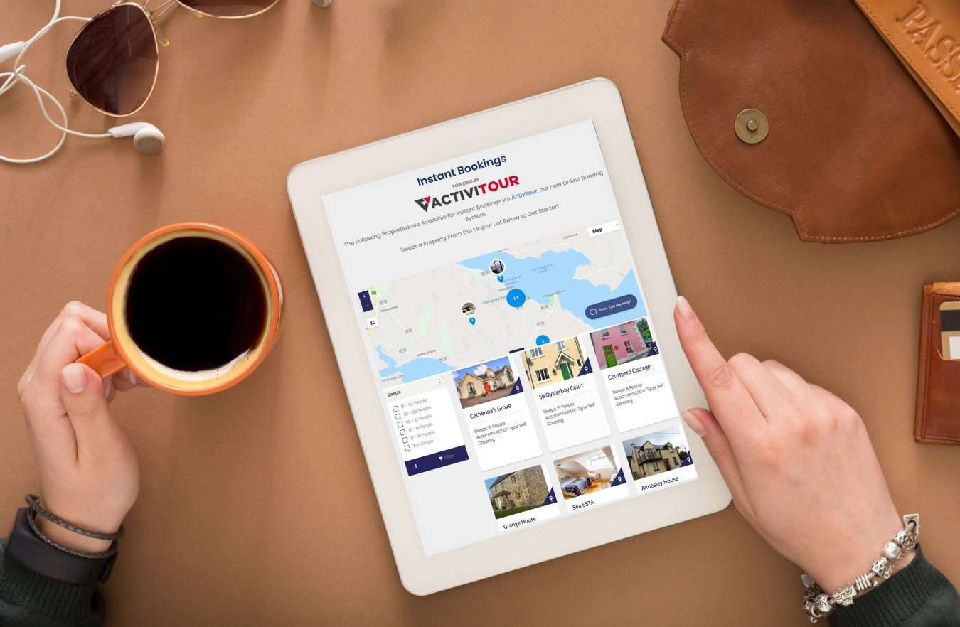 Travel planning and technologies concept. Searching or booking tickets online, preparation for summer vacation, tourist stuff and blank tablet on wooden background, top view