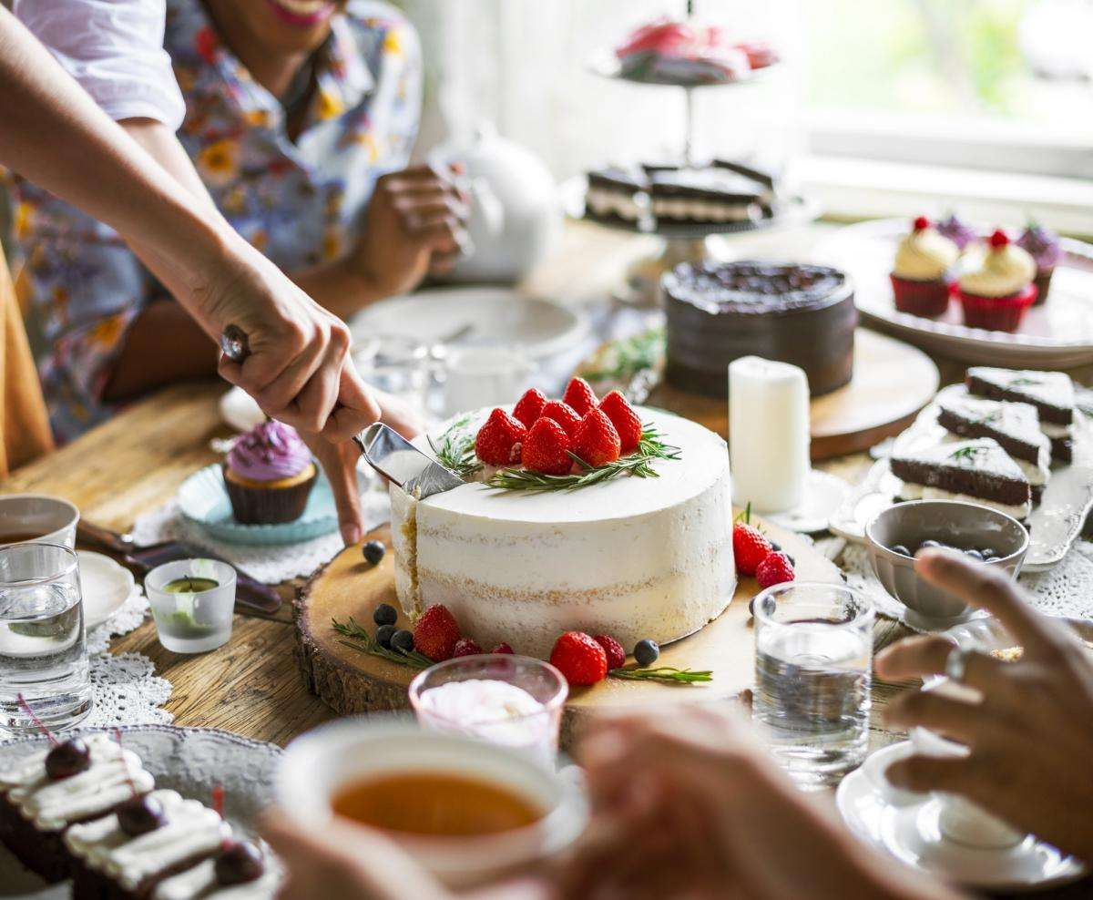 friends-gathering-together-on-tea-party-eating-cakes-enjoyment-h